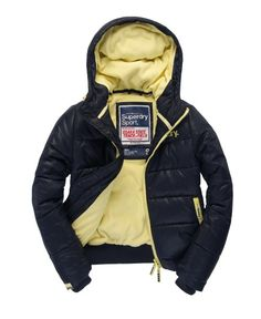 Women's Superdry Sport Polar hooded puffer jacket in classic quilted design, with zip fastening, printed chest and shoulder logos, two front pockets and contrast fleece lining.