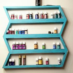 Wood Chevron shelf shown in distressed turquoise.  Available in 10 colors!