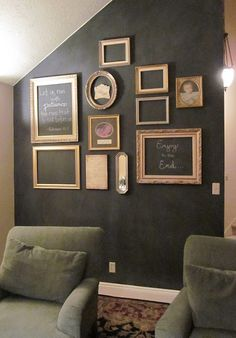 Chalkboard wall by Michelle: An eclectic grouping of frames on a blackboard backdrop: Many left empty, a few with art, & a couple filled with sayings handwritten in chalk.
