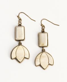 Lotus-shaped blooms dangle down for an elegant statement earring. - See more at: http://www.noondaycollection.com/earrings/laura-earrings#sthash.G0fAicwk.dpuf