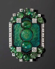 A Cartier carved emerald and diamond brooch from the Al Thani collection via thejewelleryeditor