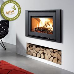 Insert stove with logs underneath - Wood Burning Fireplace Inserts Inset Fireplace, Wood Burner Fireplace, Wood Burning Fireplace Inserts, Home Fireplace, Fireplace Design, Fireplace Ideas, Kitchen Fireplaces, Wood Burning Heaters, Freestanding Fireplace