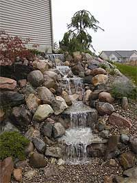 Pondless Waterfall Kit - Large Pondless Waterfalls - Add This Water Features to Your Yard.Pondless Waterfalls - Add This Water Features to Your Yard. Backyard Water Feature, Ponds Backyard, Backyard Landscaping, Landscaping Ideas, Backyard Waterfalls, Waterfall Design, Garden Waterfall, Waterfall Photo, Outdoor Water Features