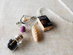 The Hunger Games inspired necklace Miniature by bottledwonders, $18.95