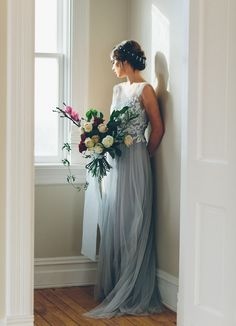 Lovely and different hair, large bouquet and non-white wedding dress in this ballet inspired shoot.
