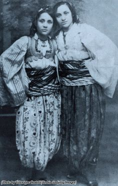 A young Albanian born Mother Teresa with her older sister Aga, in Macedonian traditional costume.