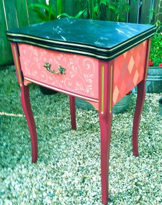 Painted sewing machine cabinet brought back to life as a dynamite side table with popping colors.. and patterns.