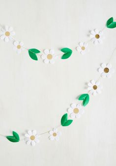 Daisy Chain Reaction Garland. Which came first - this daisy garland, or the oohs and aahs that echo throughout your party? #multi #modcloth