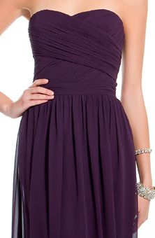 Deep purple bridesmaid's dress. The length and material make it dynamic and diverse enough to fit in any level of formality.