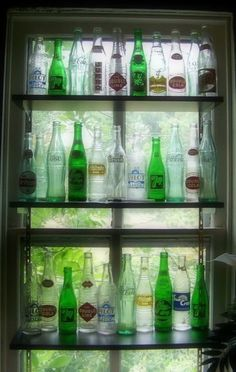 Great bottle collection display. Maybe for my son's coca cola collection.