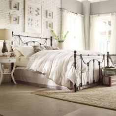 Anchor your master suite or guest room in classic style with this metal bed, showcasing rope knot details and an antique dark bronze finish.