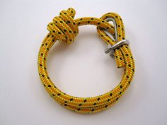 You can make one of these, too. A Nautical Bracelet (Double Wrap) with Rope Thimble. This is a sales page, I just pinned it to show the idea. #ParacordBraceletHQ