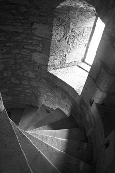 A black and white fine art photograph looking down an ancient stone spiral staircase in a castle in England with light shining in through the window to the side. Staircase Drawing, Curved Staircase, Foyers, Venice Photography, Gothic Castle, Stone Stairs, Castles In England, Art Prints For Home, Castle House