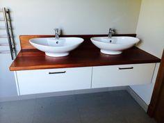 Floating vanities with solid worktops.