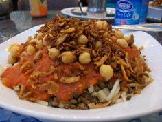 Egyptian street food - koshary/kushari/kushari/koshari. However you spell it, it looks fantastic - spiced lentils, pasta, rice, garlic tomato sauce, chickpeas, and fried onions.