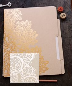 A flutter of copper leaves & silver florals adorn these kraft file folders. Perfect for collecting images, inspirations, or organizing projects. $20