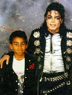 Michael and his nephew Bad World Tour 1988 backstage taking a picture of his uncle Michael Jackson Bad World Tour was the best tour ever sold out shows 125 shows thousands and thousands of people and children to see this tour. Some of the money went to charitys and princess Diana trust on July 16, 1988 in London at Wembley Stadium sold out concert what a great musical icon. His music is alive it never gets old to this day.