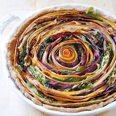 Vegan Spiral Vegetable Tart by @thecolorfulkitchen Recipe as posted on thecolorfulkitchen.com: Prep time 30 mins Cook time 45 mins Total time 1 hour 15 mins Serves: 6-8 Ingredients 1 cup spelt flour ⅓ cup vegan butter 2 tbs cold water dash of salt ½ cup pumpkin puree 2 medium eggplants 4 medium carrots cabbage laves (about half a small cabbage) 2 cups greens of your choice 2 tbs olive oil salt and pepper balsamic vinegar