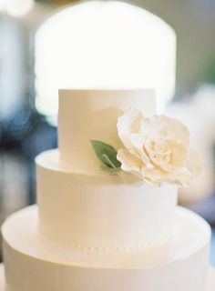 Simple white wedding cake with flower