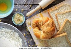bread grains and ingredients on wood table background, over light [top view]