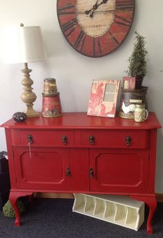 Red buffet-Annie Sloan emperors silk paint!  It's amazing how an old piece of furniture looks new and dramatic when painted.