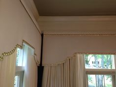 """White linen curtains, white linen cornice boards with 7/8"""" hammered brass nailheads.  Design by Lori Paranjape, Workroom: Camille Moore Window Treatments"""