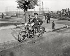 "Washington, D.C., 1932. ""Metropolitan police officer on motorcycle."" Keeping the peace in the gashouse district. Harris & Ewing glass negative."