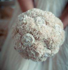 If you want to use a fabric bouquet instead of a traditional floral arrangement, try an organic cotton bouquet adorned with sustainable pearls and lace.