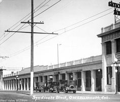 Syndicate Block, Owensmouth, circa 1920.  This building was constructed by prominent investors in the San Fernando Valley. It is located on the southwest corner of Alabama and Sherman Way. This was the first commercial building constructed after the Owensmouth Station was built. Later, the building was known as the Arcade Building. The red car tracks are located in front of the building. West Valley Museum. San Fernando Valley History Digital Library.
