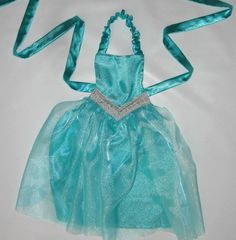 Beautiful Queen Elsa Apron. Perfect for easy dress up, themed parties or just for fun. It also layers easily over clothing for a day at the