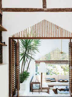A rustic beach house in bahia, brazil by the style files, via Flickr. For inspiration, love the wood trim and creamy white feel with live plants.