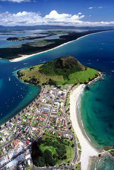 Mount Maunganui (an extinct volcano) in the town of Tauranga (settled by the Maori in the late 13 century) in the Bay of Plenty, New Zealand. Was independent from Tauranga until the completion of the Tauranga Harbour Bridge in 1988.