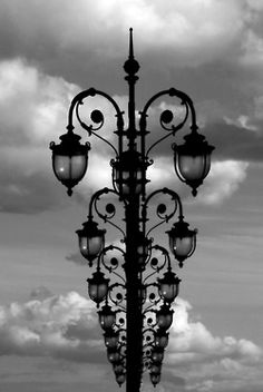Street lights black & white photo lamp posts, inline, black and white, monochromatic, clouds, sky, design, iron, lights, lamps