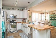 Country Kitchen with Chandelier, Subway Tile, Ikea Hammarp Butcher Block Countertop Birch, Flat panel cabinets, Pendant light