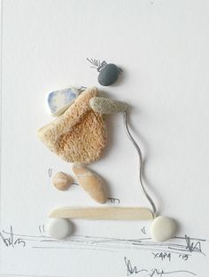 """ Making skateboard"" pebble art by Hara"