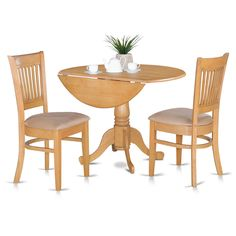 The drop leaf kitchen tables and chairs set are of small dimension, which can be ideal for smaller dining area. Constructed from asian hardwood, the round small dinette set is finished in a sleek oak finish.