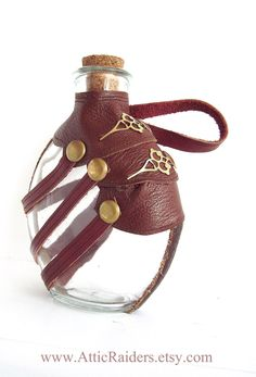 Leather Steampunk Flask. $44.99, via Etsy. I like the leather wrap but the bottle might loose its cork so I wouldn't use it
