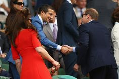 Meet and greet: The Duchess of Cambridge and Prince William meet Bear Grylls in the royal box