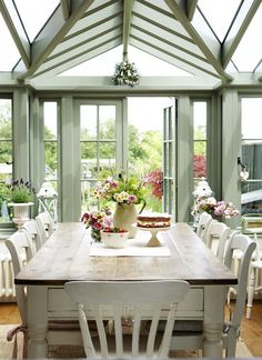 Love kitchen table leading on to orangery style bi-folding doors.....