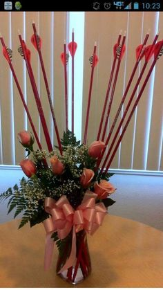 Arrow Bouquet -->  Now that's my kind of BOW-quet!!  :)
