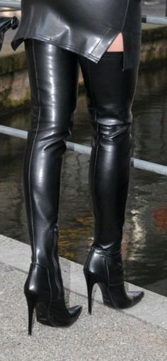 Tight black leather miniskirt and thigh boots