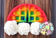 Rainbow waffles with whipped-cream clouds and Lucky Charms treasure