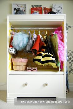 DIY Costume Closet:  If mama's little baby has grown into a big girl who loves to play dress up, we can't even picture a better costume closet than this! Jennifer, of Rambling Renovators, and her husband transformed an old dresser into a one-of-a-kind costume closet with some paint, wrapping paper and a little imagination. Check out the DIY details on their blog.