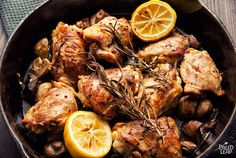 SKILLET ROSEMARY CHICKEN PALEO ...     4-6, bone-in chicken thighs, skin on or off;     20oz (about 1 lb) mixed mushrooms, cut in half;     2 sprigs fresh rosemary;     1 tbsp. fresh rosemary leaves, minced;     3 cloves garlic, minced;     2 lemons;     2 tbsp. extra-virgin olive oil;     Sea salt and freshly ground black pepper;