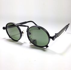 Vintage 80s NOS steampunk sunglasses, totally inspired to Gaultier 56-8171, in 5 colors.. €66.00, via Etsy.