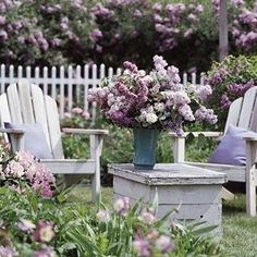 Landscape Ideas: Shabby seating area with white wood furniture & lovely lilac colors...looks amazing against the green