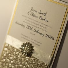 gold with brooch sequin style glitter glamour wedding invitation