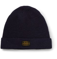 Neighborhood's founder, Mr Shinsuke Takizawa, began frequenting Tokyo's Harajuku district in the 1980s when it became an alternative-style mecca. This ribbed-knit beanie demonstrates his penchant for sub-culture cool. It's crafted from navy wool and detailed with a designer label, giving it the brand's distinctive streetwear-inspired slant.