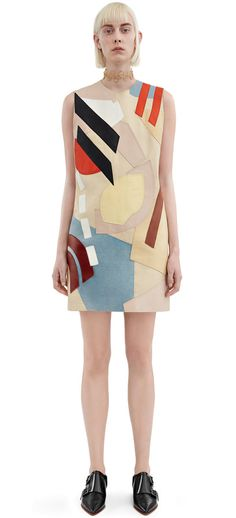 Acne Studios Helima patckwork is a leather mini dress featuring intense patchwork art in lamb leather #AcneStudios