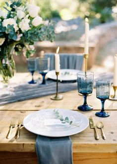 Rustic table setting with natural wood and blue